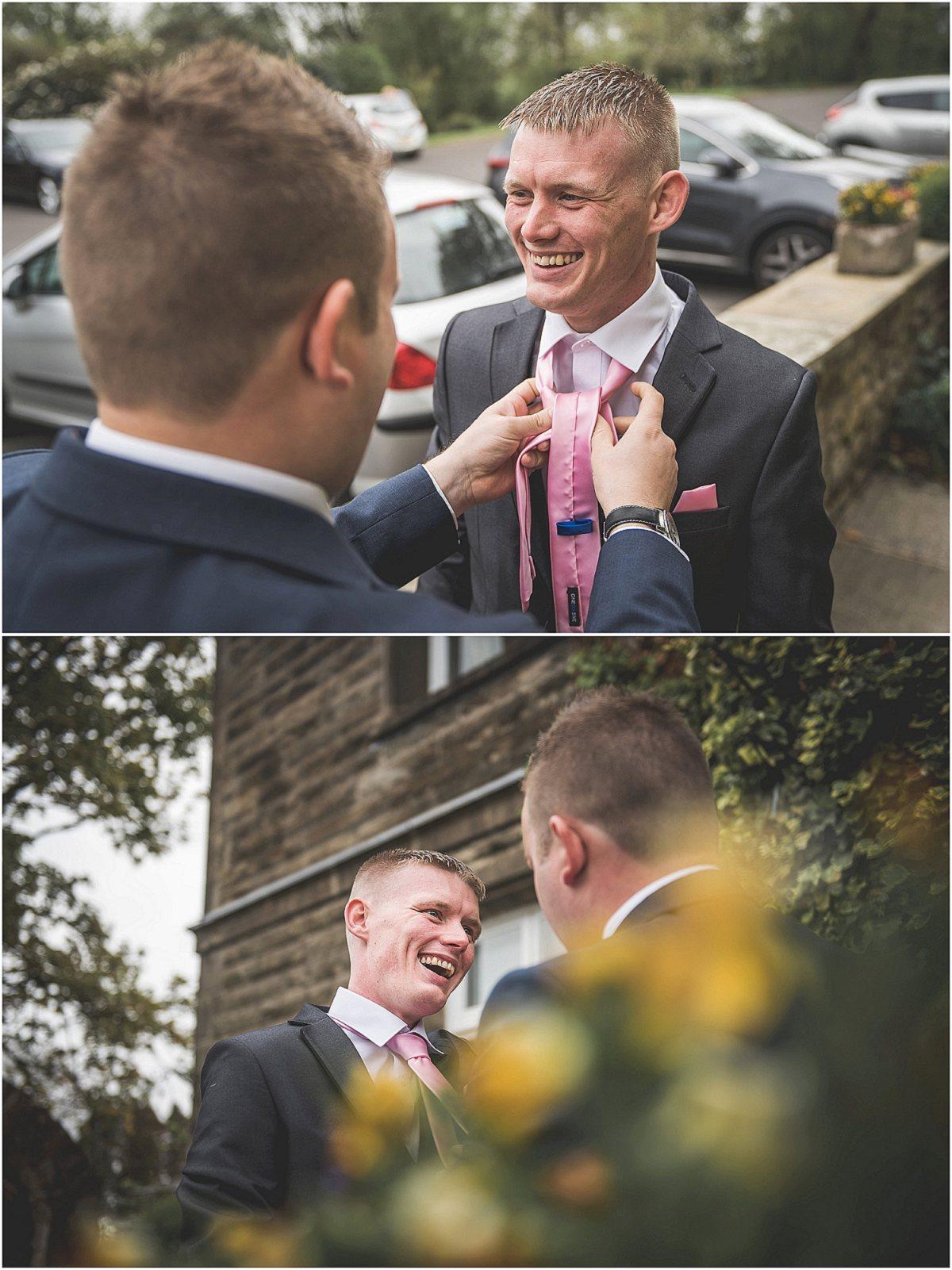 Groomsmen sorting the grooms tie