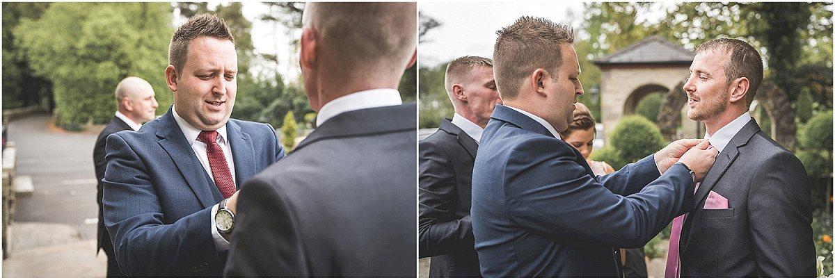 Groomsman sorting the grooms tie