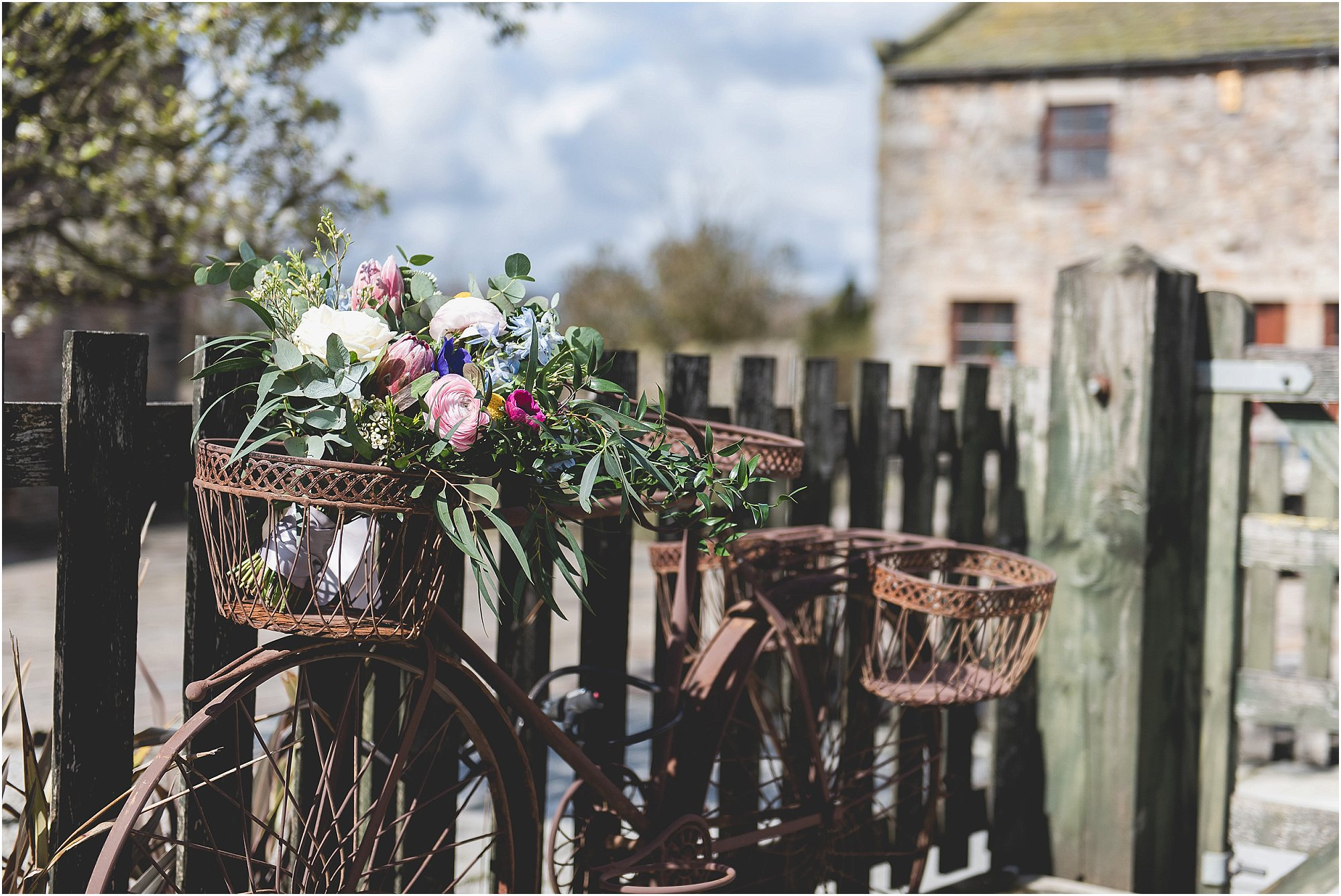 Bridal Flowers placed on an antique bike at bashall barn
